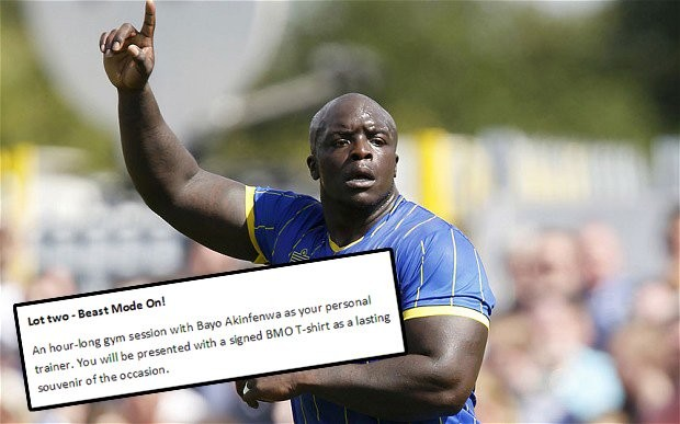 AFC Wimbledon offer gym session with striker Bayo Akinfenwa at Christmas auction