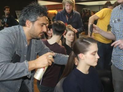 DAVINES ARTISTIC DIRECTOR, ANGELO SEMINARA, HEADS UP HAIR TEAM BACKSTAGE AT THE 1205 A/W15 LONDON FASHION WEEK PRESENTATION